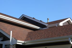 new brown asphalt shingle roof on a house